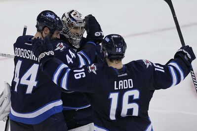 The Jets celebrate their win over the San Jose Sharks Sunday, but the players say they know they need to keep the party going to have a shot at being in the playoffs.