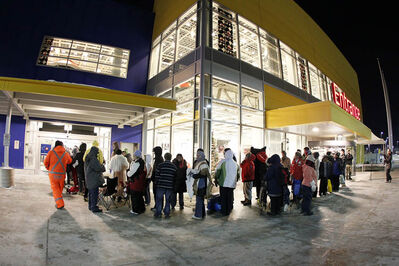 People line up at the opening of IKEA Wednesday, November 28, 2012.