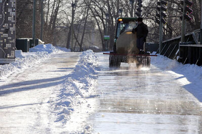 A skating trail on land at The Forks is flooded Friday. The ice on the Assiniboine River isn't thick enough for a river trail.