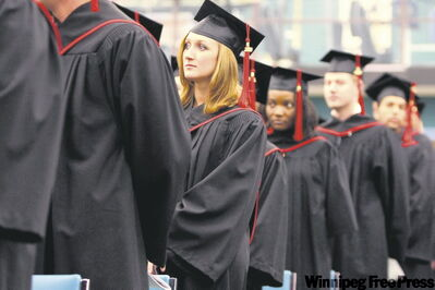 Red River College graduates await diplomas during graduation ceremony.