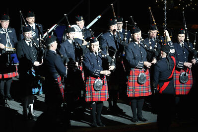 The Winnipeg Police Pipe Band performs at a memorial service for victims of the Connecticut massacre at MTS Centre, Saturday.