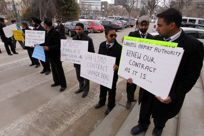 Limo drivers protest in front of the Manitoba Legislative Building on Friday morning.