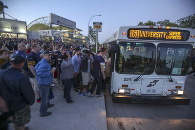Bombers fans pile onto buses at the conclusion of the inaugural Winnipeg Blue Bombers game at the new Investors Field Stadium against the Toronto Argonauts on June 12. Leaving the stadium was much simpler than arriving on time for the game.