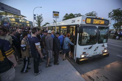 Blue Bombers fans pile onto buses after a game at Investors Group Field in 2013.