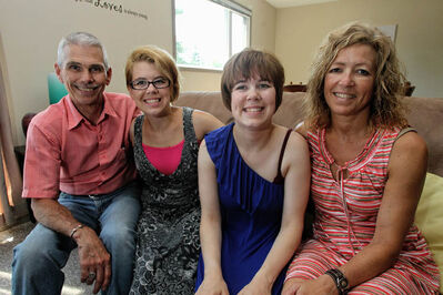 """Bob and Karen Webb with their daughters Karly (left) and Courtney at their Pulford Community Living Services home. """"It's been a great experience"""", says Bob."""