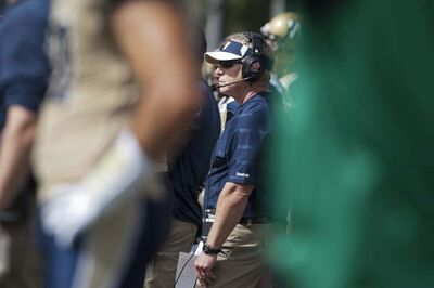 Winnipeg Blue Bombers head coach TIm Burke looks on as his team takes on the Saskatchewan Roughriders during the first half of CFL football action in Regina, Sask., Sunday, September 1, 2013.