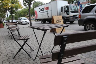 A truck roars down Provencher Boulevard near Café Postal. The numerous trucks that travel past this streetside patio many times a day exemplify one of the main problems with Winnipeg's 'stroads.'