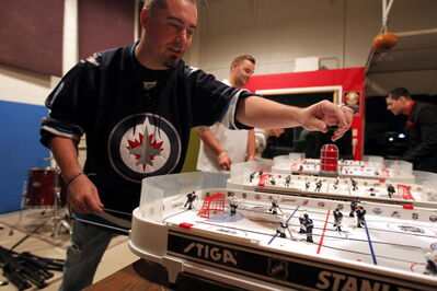 Chad Brown and his We're Better than the Other Winnipeg Table Hockey League League: 'So far I've blown about $1,000 out of my own pocket just to have fun with my crazy friends.'