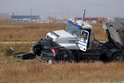 One person has died after a gravel truck and a small car collided near Gunn Road and the Perimeter Highway.