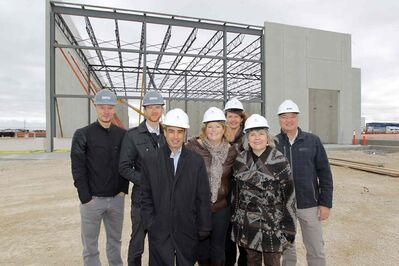 Bird Construction's (from left) Nathan Wiebe and Paul Bergman, Shindico Realty's Robert Scaletta, CentrePort CEO Diane Gray, RM of Rosser Coun. Angela Emms, Rosser Reeve Frances Smee and Bird Construction's Richard Marshall in front of the partially constructed building in CentrePort.