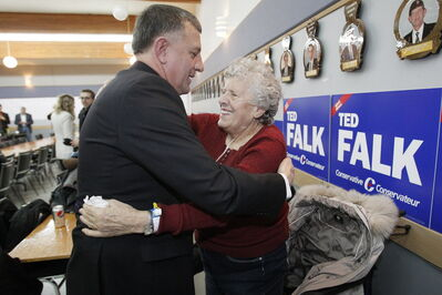 Conservative Ted Falk greets his mother Jessie at his Steinbach headquarters after winning the Provencher byelection.