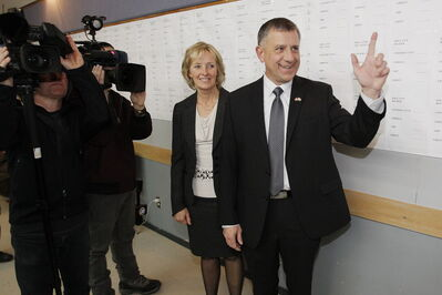 Conservative Ted Falk and his wife greet supporters at his Steinbach headquarters after winning the Provencher byelection.