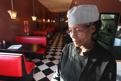 Thea Morris stands in the same diner a gay couple closed in April after being subjected to homophobic verbal attacks.