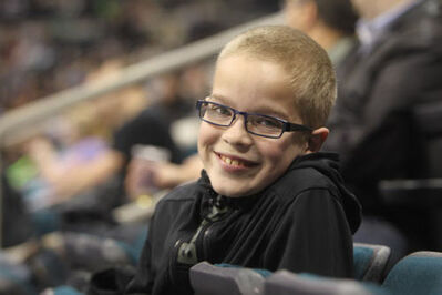 Curling fanatic Logan Ede of Saskatchewan is all smiles Thursday while in the stands at Roar of the Rings.