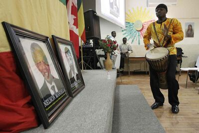 Evans Coffie performs Sunday at the Ethiopian Cultural Centre, celebrating the life of Nelson Mandela.