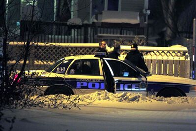 Police surround a home on Magnus Avenue after a shooting Thursday night sent one man to hospital.