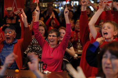 Annette and husband Dennis Lafreniere were among many at the St. Vital Curling Club celebrating Canada's gold-medal win in Olympic women's curling Thursday morning.