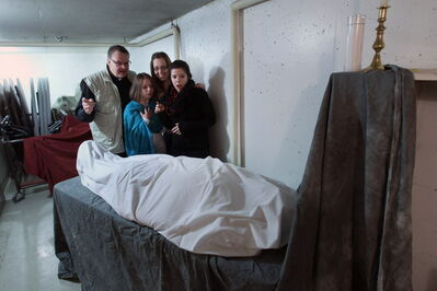 Father Mark Gnutel (from left), Nadia Panas, Michelle Thiessen and Liz Artmyko and Andrew Konoplny (under sheet).