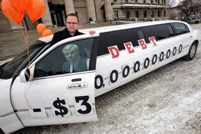 Colin Craig, with the Canadian Taxpayers Federation, and the limo with the $30-billion debt threshold, recently crossed by the provincial government, plastered on its side in front of the Legislative Building this morning.