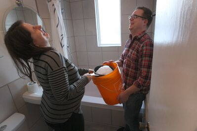 Laresa and Brent Sayles share a laugh as they try to use snow for toilet flushing water.
