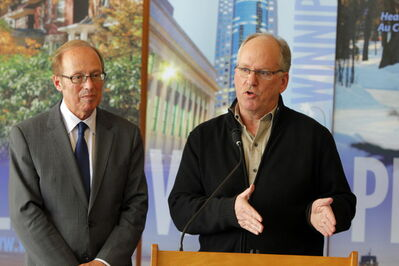 Sam Katz, left, and Winnipeg emergency co-ordinator Randy Hull discuss the city's water woes.