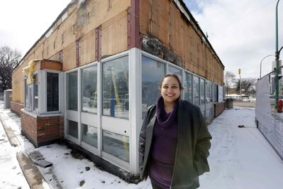 Jyoti Singh outside the former Chicken Delight at Corydon Avenue and Stafford Street, currently being converted into a new Harvey's/ Swiss Chalet.