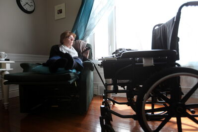 Bev Bungay reclines in her specialized chair with her cane by her side as she slowly recovers from an accident in which she broke 11 bones after being hit by a car. She shared her story as part of the Winnipeg Free Press' series on traffic safety.