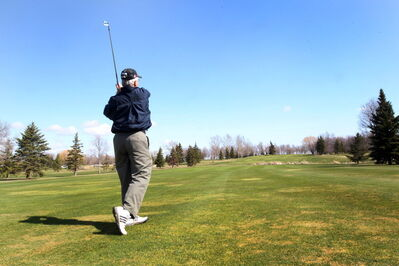 Gary Nazer hits one on the sixth hole at the Fly-In Golf Club. The Steinbach golf course is celebrating its 60th anniversary this year.