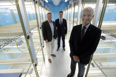From left, Prof. Mike Dixon, Steve Kroft and his father, company founder Richard Kroft, pose in a newly constructed Conviron growth room.