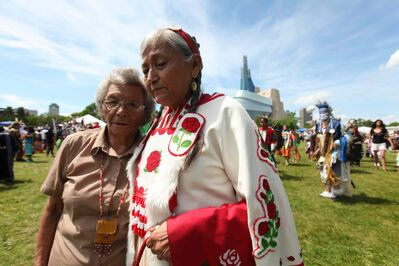 Gloria Chocan (right) and her sister Rosalie Chokin of Onion Lake Cree Nation attend the Powwow on the fields at the Forks National Historic site for Aboriginal Day Saturday afternoon. Gloria Chocan along with 10 other older Cree women are trying to get Ottawa to notice the issues facing their people by travelling from Ottawa to their reservation in Alberta.