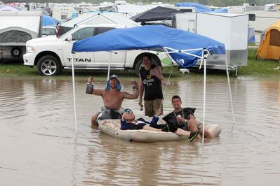Rain hits the festival Friday evening, but that couldn't dampen the party atmosphere at the annual country-music event.
