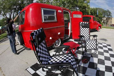 Kelly Klick polishes her 1975 Boler camper (John Woods / Winnipeg Free Press)
