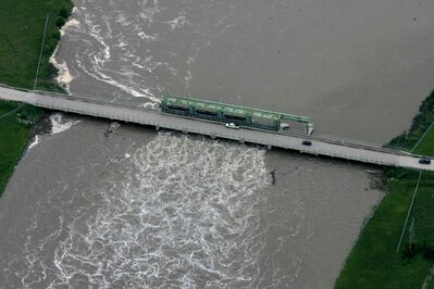 Aerial photo of bridge over the  Portage diversion dam just west of town where water is diverted north to Lake Manitoba.