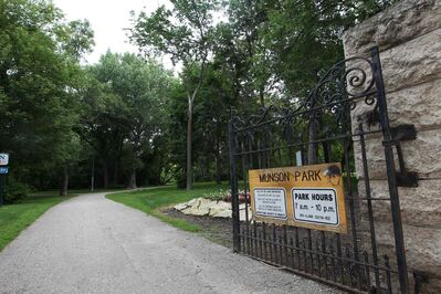 Munson Park, with its small strip of trails on the banks of the Assiniboine River, is framed by a wrought-iron fence spaced at intervals with Tyndall stone gates. Most everyone who visits comes in ones and twos.