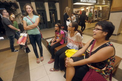 Deanna Otto and her kids Storm,13, Cadence, 11, and Brooklyn, 17 back-to-school shopping.