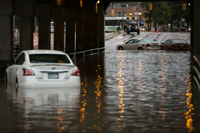 Abandoned cars at the flooded underpass at Higgins and Main Street around 8 p.m. Thursday night.
