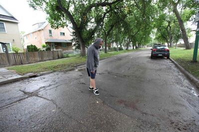 David Gaumond, a Spence area resident, describes the scene  after a stabbing occurred early Saturday morning in 500 block of Spence Street.