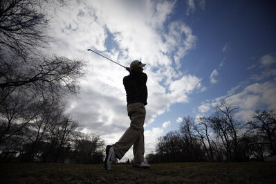 A golfer heads out for a round Monday at Kildonan Park Golf Course. The weather has resulted in later opening rounds than usual, causing some golf course operators to worry about the year's revenue.