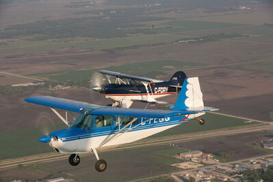 Pilot Luke Penner flies the Pitts S2B aerobatic biplane in formation with a Cessna over Steinbach.