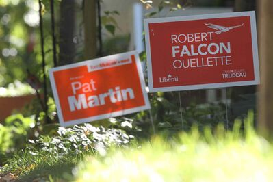 Pat Martin and Robert Falcon Quellette Elections signs stand next to each other on front lawns throughout the Wolsely area.