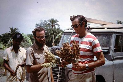 Art DeFehr (right) tours an agricultural program in Bangladesh in the 1970s. The CEO has been visiting some of the world's most troubled places for decades.