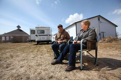 Wayne Drummond and his wife Donna, who has been farming in the Lauder area of southwestern Manitoba for 50 years, had to evacuate their home and are living in a trailer.