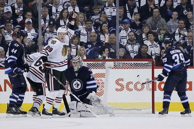 Chicago Blackhawks' Bryan Bickell (29) celebrates Nick Leddy's (8) goal against the Winnipeg Jets during the second period.