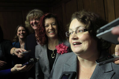 From right, Jennifer Howard, Sharon Blady, Erna Braun and Erin Selby are elevated to top portfolios in Selinger's new cabinet.