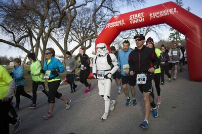 Darrell Saria runs the 10th annual Winnipeg Police Service half marathon Sunday in a Star Wars storm trooper costume to celebrate the movie on Star Wars day, May 4.