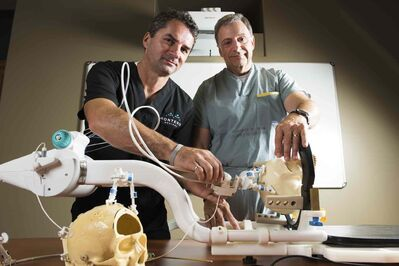 Dr. Mark Torchia (right) first envisioned the NeuroBlate in the early 1990s and was joined in the quest by Richard Tyc in 1998. It is now in use in 35 locations across North America.