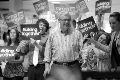 Greg Selinger with supporters at St. Boniface College Monday. The NDP leader says he'll roll out part of his platform today.