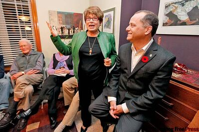 John Woods / Winnipeg Free Press NDP leadership candidate Brian Topp (right) meets with party faithful at the home of Judy Wasylycia-Leis (centre).