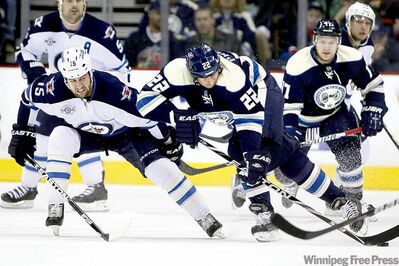 Terry Gilliam / the associated pressBlue Jacket Vinny Prospal (22) controls the puck as Tanner Glass pursues.