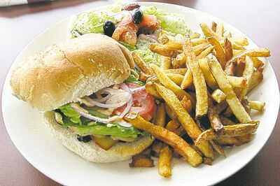 Most Canadians dine out at lunch at least once a week, a new survey suggests.